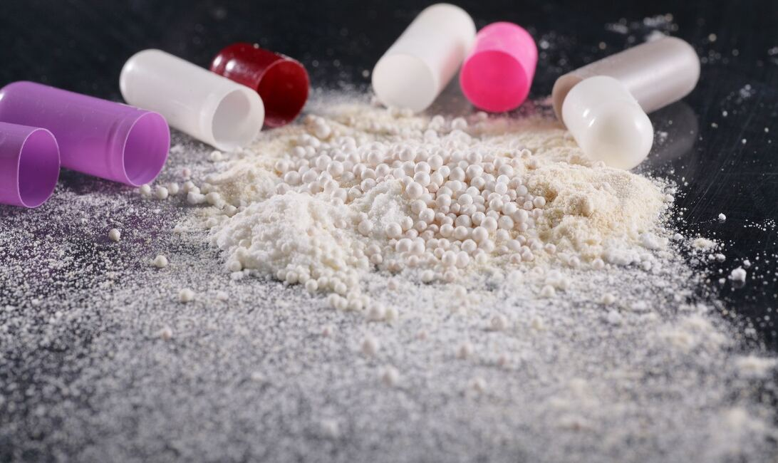 Opened pills with drug powders spilling out