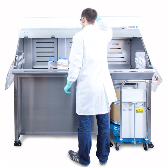 Analyst working with a Bulk Powder Weighing enclosure